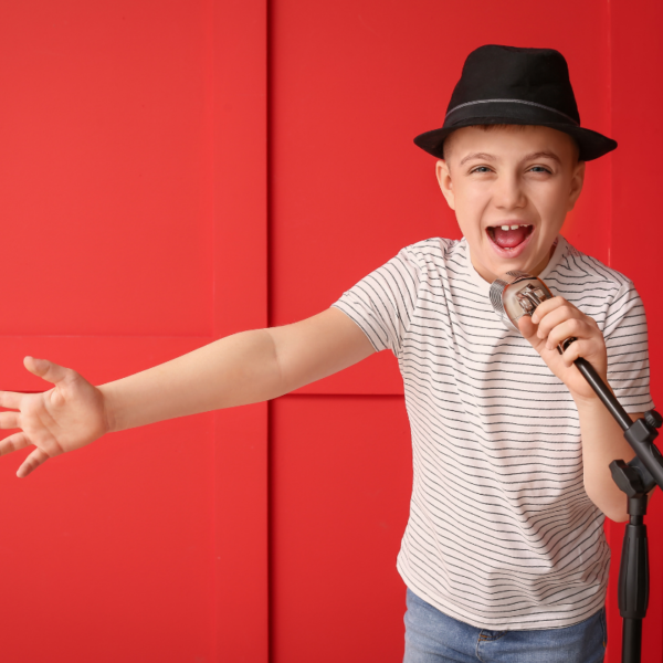 Picture of boy holding a microphone while singing